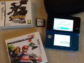 Nintendo 3DS, case, charger and games