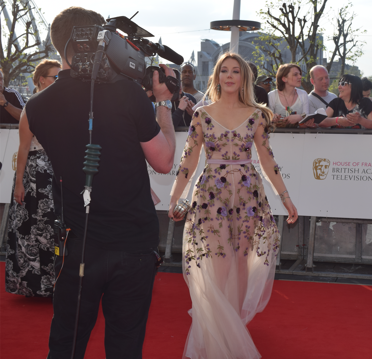 Funny woman Katherine Ryan flaunts her curves in a sheer gown.