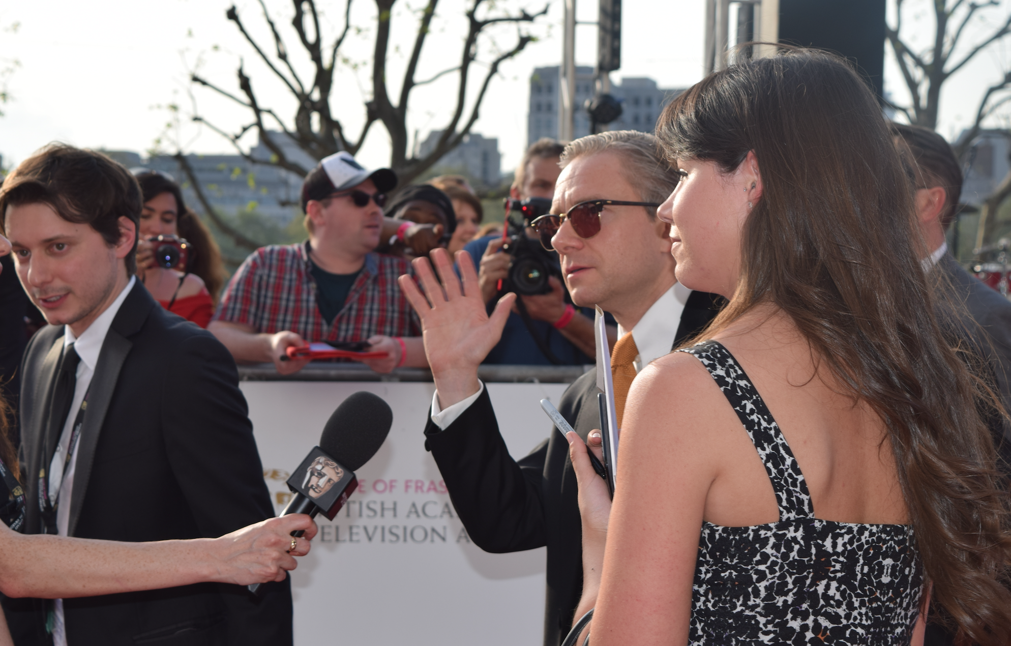 Sherlock's Martin Freeman gives a cool wave, but no interviews, to the press.